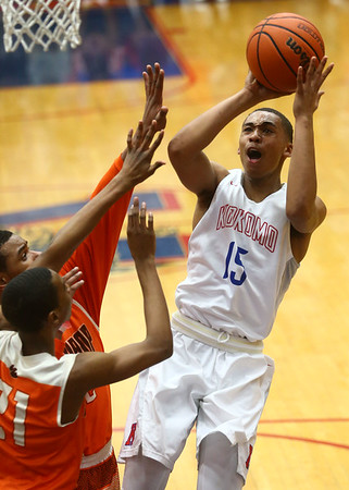 2-24-17<br /> Kokomo vs Fort Wayne Northrop boys basketball<br /> Elonte O'Bannon shoots.<br /> Kelly Lafferty Gerber | Kokomo Tribune