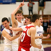 2-17-17<br /> Northwestern defeats Twin Lakes 56-48 for the Hoosier Conference Championship<br /> NW's Collin Hodson celebrates with teammates at the end of the game.<br /> Kelly Lafferty Gerber | Kokomo Tribune