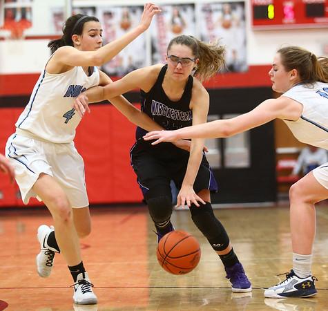 2-11-17<br /> Northwestern vs South Bend St. Joseph girls bball regional<br /> NW's Madison Layden tries to regain control of the ball from South Bend St. Joseph's defense.<br /> Kelly Lafferty Gerber | Kokomo Tribune