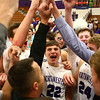 2-17-17<br /> Northwestern defeats Twin Lakes 56-48 for the Hoosier Conference Championship<br /> Eli Dubbels cheers with the team after the Hoosier Conference Championship win.<br /> Kelly Lafferty Gerber | Kokomo Tribune