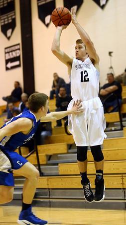 2-21-17<br /> Western vs Carroll boys basketball<br /> Western's Cooper O'Neal shoots and gets fouled.<br /> Kelly Lafferty Gerber   Kokomo Tribune