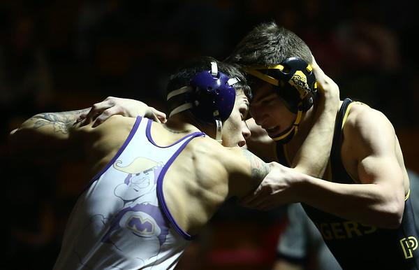 2-4-17<br /> Regional wrestling<br /> Peru's Carter Kintner and Marion's Lorenzo Trevino in the 138.<br /> Kelly Lafferty Gerber | Kokomo Tribune