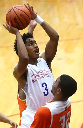 2-24-17<br /> Kokomo vs Fort Wayne Northrop boys basketball<br /> Keenen Wheeler shoots.<br /> Kelly Lafferty Gerber | Kokomo Tribune