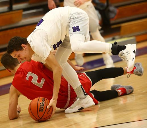 2-2-17<br /> Northwestern vs West Lafayette boys basketball<br /> NW's Tyler Foster scrambles for posession of a loose ball.<br /> Kelly Lafferty Gerber | Kokomo Tribune