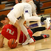 2-2-17<br /> Northwestern vs West Lafayette boys basketball<br /> NW's Tyler Foster scrambles for posession of a loose ball.<br /> Kelly Lafferty Gerber | Kokomo Tribune