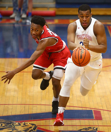 2-10-17<br /> Kokomo vs Richmond boys basketball<br /> Kokomo's Jeremy Baker dribbles down the court.<br /> Kelly Lafferty Gerber   Kokomo Tribune
