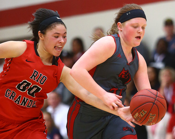 2-22-17<br /> IUK vs Rio Grande girls basketball<br /> IUK's Payton Thomson tries to keep control of the ball while Rio Grande's Sydney Holden tries to take over.<br /> Kelly Lafferty Gerber | Kokomo Tribune