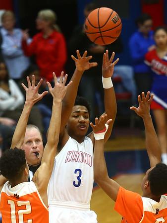 2-24-17<br /> Kokomo vs Fort Wayne Northrop boys basketball<br /> Keenen Wheeler throws a pass over Northrop's defense.<br /> Kelly Lafferty Gerber   Kokomo Tribune