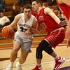 2-2-17<br /> Northwestern vs West Lafayette boys basketball<br /> NW's Noah Dowden tries to dribble around WL's defense to the basket.<br /> Kelly Lafferty Gerber | Kokomo Tribune
