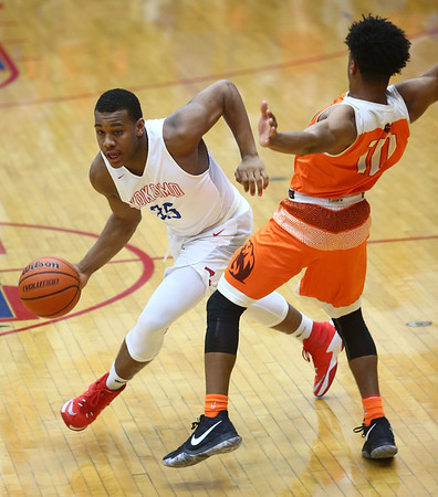 2-24-17<br /> Kokomo vs Fort Wayne Northrop boys basketball<br /> Jeremy Baker dribbles down the court.<br /> Kelly Lafferty Gerber | Kokomo Tribune