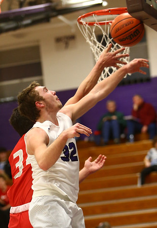 2-2-17<br /> Northwestern vs West Lafayette boys basketball<br /> NW's Noah Dowden swats the ball away from the basket as WL tries to score.<br /> Kelly Lafferty Gerber   Kokomo Tribune