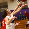 2-2-17<br /> Northwestern vs West Lafayette boys basketball<br /> NW's Noah Dowden swats the ball away from the basket as WL tries to score.<br /> Kelly Lafferty Gerber | Kokomo Tribune
