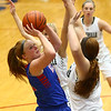 2-3-17<br /> Kokomo vs Zionsville girls basketball<br /> Kokomo's Madison Wood looks to the basket over Zionsville's defense.<br /> Kelly Lafferty Gerber | Kokomo Tribune