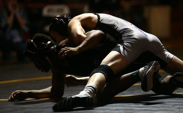 2-4-17<br /> Regional wrestling<br /> Western's Hunter Cottinghman and Marion's Jaylon Gibson in the 126.<br /> Kelly Lafferty Gerber   Kokomo Tribune
