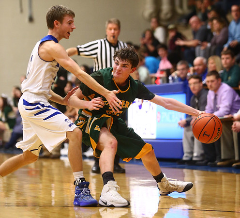 2-7-17<br /> Tipton vs Eastern boys basketball<br /> Eastern's Ethan Henry looks for a pass around Tipton's defense.<br /> Kelly Lafferty Gerber | Kokomo Tribune