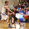 2-7-17<br /> Tipton vs Eastern boys basketball<br /> Eastern's Ethan Henry looks for a pass around Tipton's defense.<br /> Kelly Lafferty Gerber | Kokomo Tribune