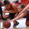 2-22-17<br /> IUK vs Rio Grande girls basketball<br /> Rio Grande's Jaida Carter and IUK's Mackenzie Johnson go after a loose ball.<br /> Kelly Lafferty Gerber | Kokomo Tribune