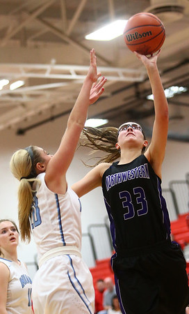 2-11-17<br /> Northwestern vs South Bend St. Joseph girls bball regional<br /> NW's Madison Layden shoots.<br /> Kelly Lafferty Gerber | Kokomo Tribune