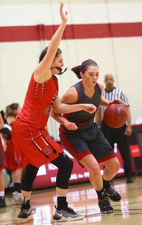 2-22-17<br /> IUK vs Rio Grande girls basketball<br /> IUK's Abby Scott looks to get around Rio Grande's defense.<br /> Kelly Lafferty Gerber | Kokomo Tribune