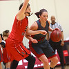 2-22-17<br /> IUK vs Rio Grande girls basketball<br /> IUK's Abby Scott looks to get around Rio Grande's defense.<br /> Kelly Lafferty Gerber | Kokomo Tribune