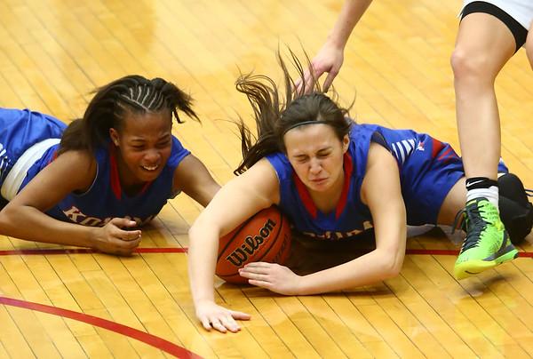 2-3-17<br /> Kokomo vs Zionsville girls basketball<br /> Kokomo's Tionna Brown and Olivia Branch try to get a loose ball.<br /> Kelly Lafferty Gerber | Kokomo Tribune