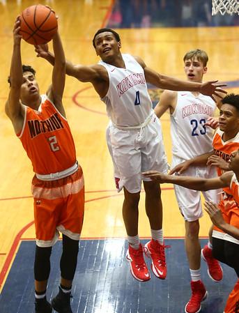 2-24-17<br /> Kokomo vs Fort Wayne Northrop boys basketball<br /> Trajan Deckard goes after a rebound.<br /> Kelly Lafferty Gerber   Kokomo Tribune