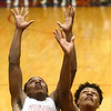 2-24-17<br /> Kokomo vs Fort Wayne Northrop boys basketball<br /> Brevin Beard and Northrop's Richard Robertson go after a rebound.<br /> Kelly Lafferty Gerber | Kokomo Tribune