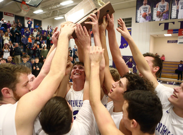 2-17-17<br /> Northwestern defeats Twin Lakes 56-48 for the Hoosier Conference Championship<br /> Northwestern's boys basketball team celebrates after their win.<br /> Kelly Lafferty Gerber   Kokomo Tribune