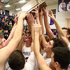 2-17-17<br /> Northwestern defeats Twin Lakes 56-48 for the Hoosier Conference Championship<br /> Northwestern's boys basketball team celebrates after their win.<br /> Kelly Lafferty Gerber | Kokomo Tribune