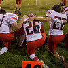 Several ERHS players take a moment to pray together before the start of the game