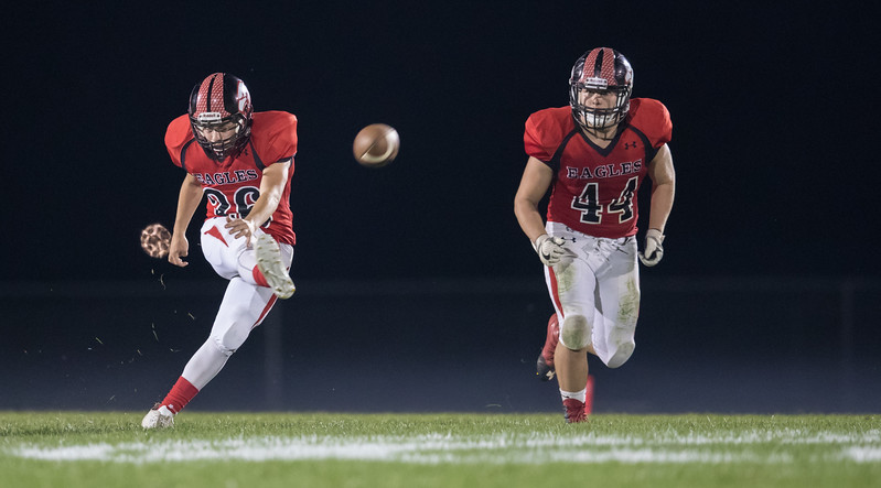 Colby Price kicks off the ball after another Eagles score