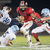 Jwan Evans eludes the Panther defense, Daniel Cubbage(35), Trey Knight III (5), and Tristan Gordon (65)