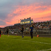 The sunsets behind the home team bleachers