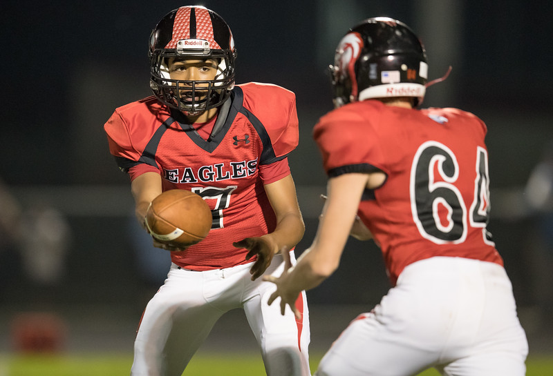 Tyce McNair prepares to hand the ball off to Timmy Davis