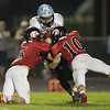 Trenton Morris (5) and Chandler Breeden (10) take down Panther QB William Hart