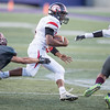 Jwan Evans tries to elude Trevor Craig (14) and  Antonio Ruiz-Haynes (22)