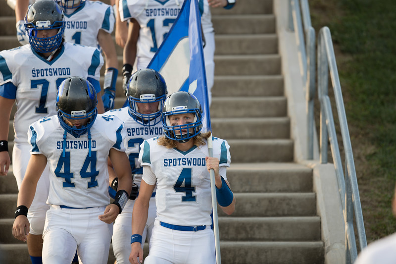 Alec High carries Spotswood flag out to the field