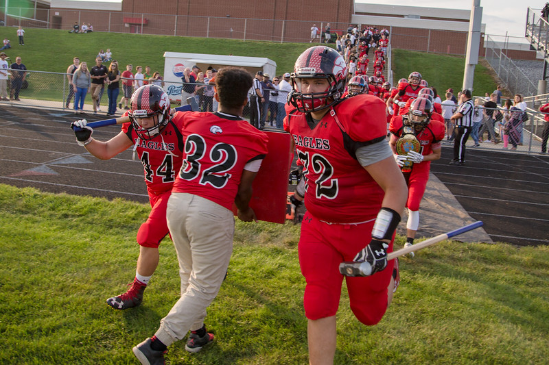 Logan Dofflemyer and Ivan Ritenour lead the Eagles out on to the field