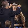 Homecoming Queen Luren Fridley is crowned by principal Robert Dansey