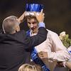 Homecoming King Matthew Mozingo is crowned by princepal Robert Dansey