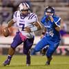 Waynesboro's quarterback DaJuan Moore runs to get away from Drake Tomasi.