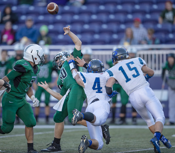#4 grabs on to Broadway's quarterback Nicholas Lohr as he releases the pass