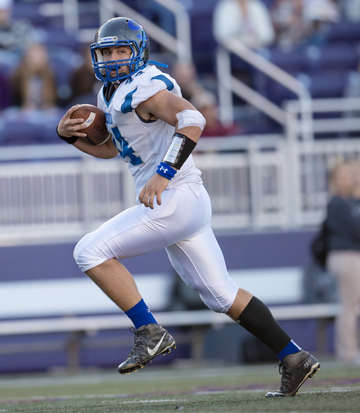 Michael Cekada runs the ball in for the first touchdown of the game.