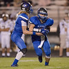 Alec High hands off the ball to Brennan Brown