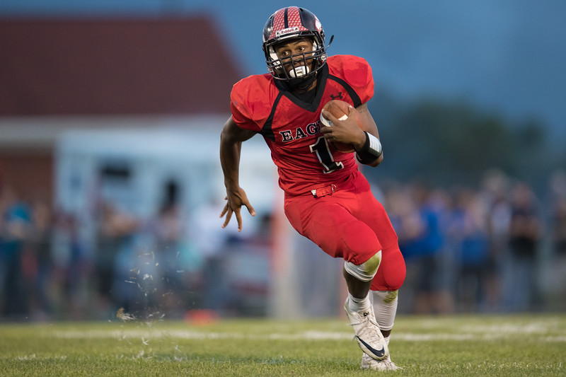 Jwan Evens cuts around the edge of the Blazers defense to score ERHS' first touch down