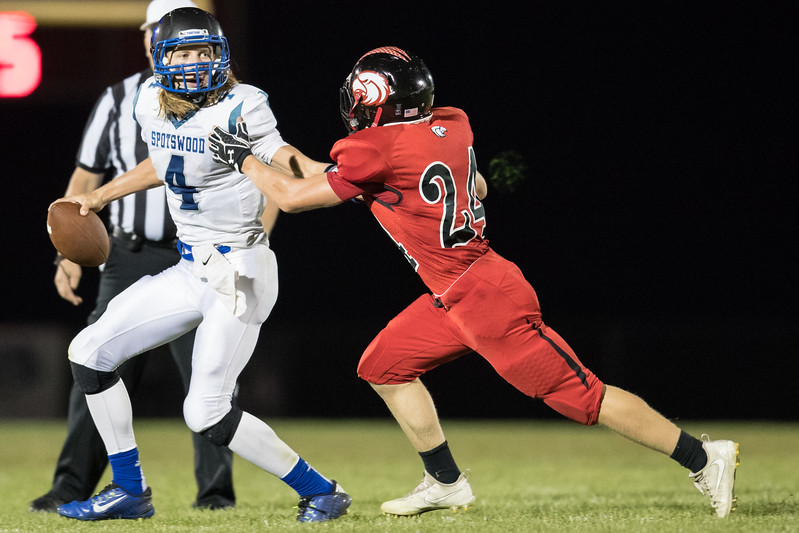 Colton Dean rushes in on Alec High forcing him to thow away the ball.