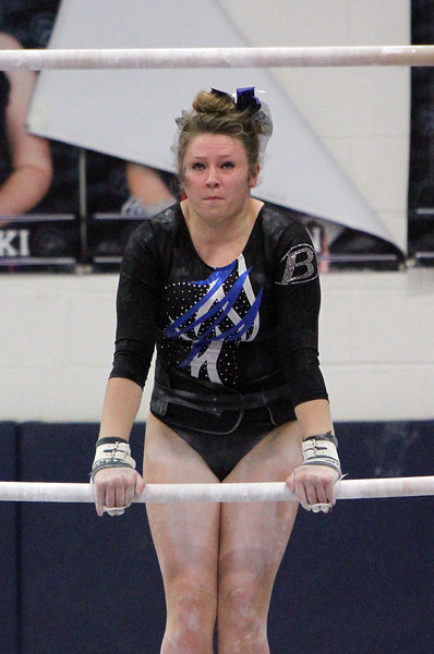 ANNA NORRIS/GAZETTE Brunswick's Jessica Froncek competes on the uneven bars during the Northeast Ohio sectional gymnastics meets Sunday afternoon at West Geauga High School.