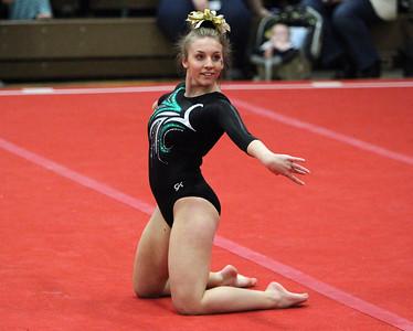 ANNA NORRIS/GAZETTE Medina's Lauren Romano performs her floor routine during the Northeast Ohio sectional gymnastics meet Sunday afternoon at West Geauga High School.