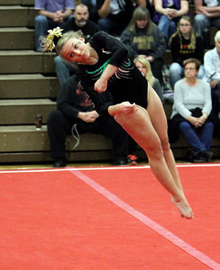 ANNA NORRIS/GAZETTE Medina's Lauren Romano executes a full twisting flip during a tumbling pass in her floor routine in the Northeast Ohio sectional gymnastics meet Sunday afternoon at West Geauga High School.