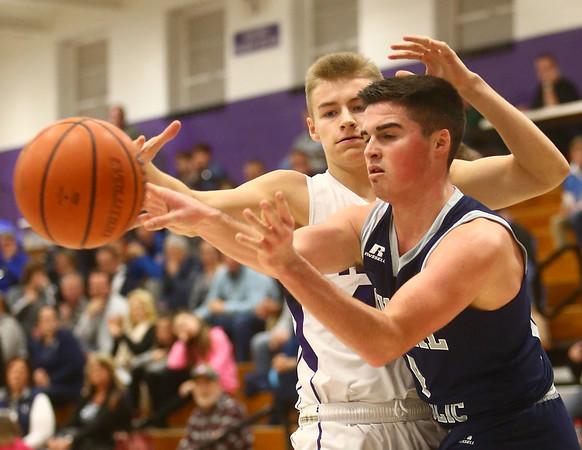 1-3-17<br /> Northwestern vs Central Catholic boys basketball<br /> CC's Thomas Gothard looks for a pass.<br /> Kelly Lafferty Gerber   Kokomo Tribune